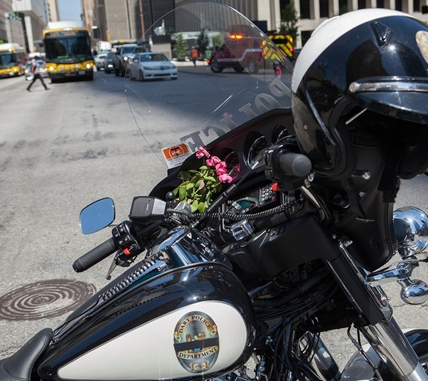 DPD_motorcycle_and_flowers use ONLY with Texas Tribune article